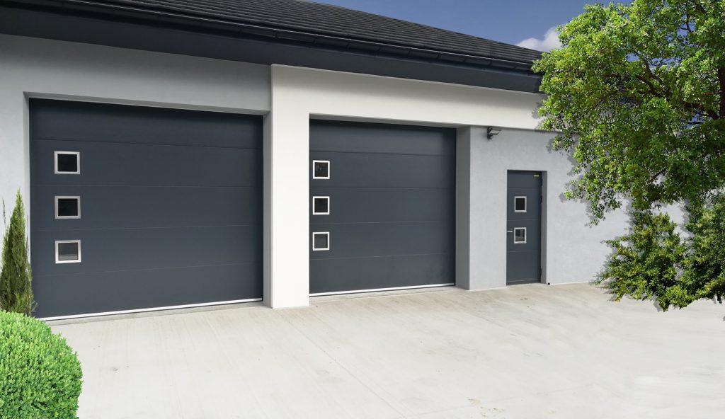 Bramy garażowe segmentowe antracytowe z nierdzewnymi okienkami